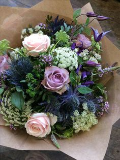 Memory lane and sweet avalanche roses with ammi, clematis and thistle made by Rachel