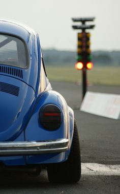 At the Tree. blue VW Beetle racing