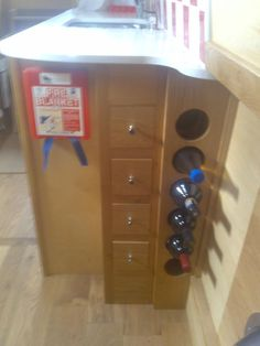 Wine Bottle Storage But Needs Strap Over Neck Fasting To Frame To