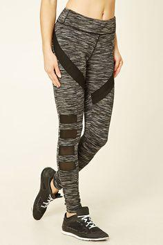 A pair of stretch-knit space dye leggings featuring geo-shaped mesh panels, an elasticized waist with a hidden drawstring, moisture management, and a hidden key pocket.