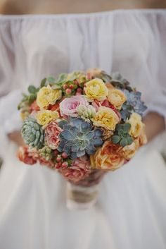 Amazing flowers for a Spanish inspired wedding. Love the use of succulents. Check out rest of the wedding. Beautiful.