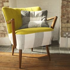 Statement armchair - love the shade of green with the soft grey and white stripe