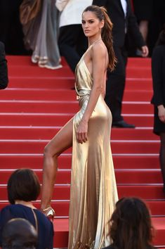 "Strike a pose! Izabel Goulart wearing Alexander Vauthier Couture golden dress at the ""The Last Face"" Premiere during the 69th annual Cannes Film Festival. #cannes #festivaldecannes #izabelgoulart"
