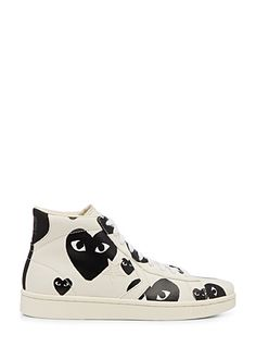 Comme des garçons PLAY joins forces with Converse to give us a fun high-quality espadrille, worn in a casual chic style to add colour and imagination to any outfit.    Solid ivory canvas with faux-wax logo prints   Strong rubber outer sole   Model number : P1-K109