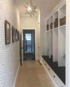 Where would I be without our mudroom? With three kids it's heaven sent. You can't usually see the floor though. Honed granite bench top and hardware from @potterybarn. I have a star pendant like this for sale in my @dirtyjanesbowral stall too #home #mudroom #wallpaper #thibaut #animalprint @boyac