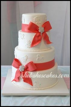"""Cute cake with coral """"ribbon"""".. this would be a SUPER cheap wedding cake.. hooray to that!"""