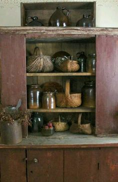 Old Primitive Cupboard...old brown crocks & baskets...Karen Gerhardt.
