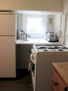 Kitchen Small Fridges, One Bedroom Apartment, Rental Apartments, Cookware, Kettle, Freezer, Dinnerware, Oven, Plates