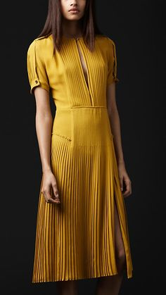 Pleated, not striped. But the pleats have a similar visual effect to stripes.Yellow dress.. Burberry.