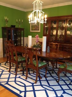 Kelly green dining room with blue and white trellis rug and bamboo chandelier; traditional with touch of chinoiserie - Birds Of A Feather