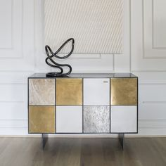KELLY WEARSTLER | HUNTLEY CREDENZA. Blackened stainless steel body and solid walnut drawers and shelving