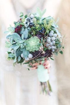 Loving all these textures in thus stunning Grey Green Sage Succulents wedding bouquet.