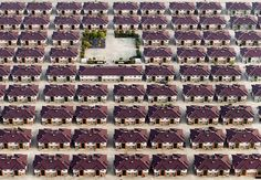 Rows of identical houses with a playground seen in the middle in the city of Jiangyin, Jiangsu, China. © Kacper Kowalski, Poland – 2014 Sony World Photography Awards, Professional Category, Contemporary Issues subcategory.