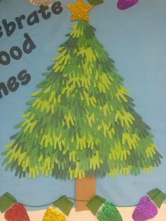 While yours doesn't have to be as big we filled up our bulletin board with a hand print Christmas tree. We traced each child's hand and then cut them out on various shades of green construction paper. We then glued the together to create a beautiful tree :)