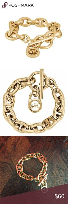 """Authentic Michael Kora Toggle Bracelet Authentic Micheal Kors Gold Heritage Fulton Padlock Station Woman's Bracelet. This classic bracelet is 8"""" long & features a lustrous hardware & signature MK logo Charm. In perfect condition and never been worn! Michael Kors Jewelry Bracelets"""