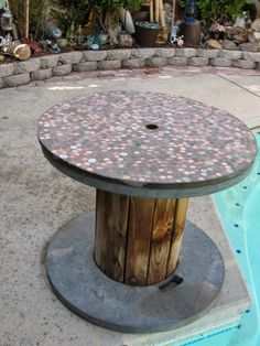 Larger penny table made using a large wire spool.