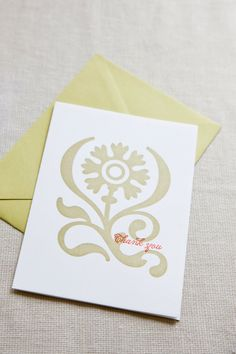Two color letterpress folded thank you card with green envelope.