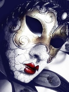 Venetian Mask - I like the colour contrast of the red lips to the white background of the mask.