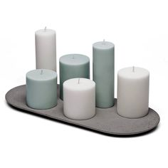 Versatile flat candle plate designed by Doreen Westphal and handmade in the Netherlands. This generously sized (419 mm) oval design allows for a gracious personalized combination of candles in different sizes and/or colors. Also suitable as trivet. . . #concretedesign #sale #concrete #candleholder #candle #beton #uniquedesign #interiordesign #design #functionalart