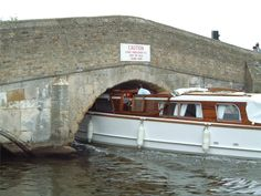 potter heigham bridge. Pilots took hire boats under the bridge using speed on approach to create displacement for the boat to drop into when they took the power off.