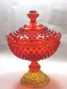 Fenton orange hobnail footed and covered candy dish from GrandmasAntiques