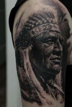 American Indian Chief half sleeve tattoo by Dmitriy Samohin.