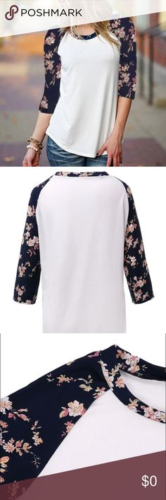 """HP! RAGLAN TOP WITH NAVY BLUE FLORAL SLEEVES Adorable baseball style floral sleeve top. 3/4 length sleeves. White body. Navy blue and floral sleeves. All have an approx length of 26"""". The armpit to armpit measurement is as follows (approx). M - 17""""; L - 18""""; XL - 19"""". These appear to run a tad small so if concerned, order a size up. NWT LEFT OR RIGHT Tops"""