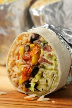 A vegan burrito recipe that is super filling, hearty, flavorful and every kind of delicious! Stuffed with black beans and corn, rice, vegan sour cream and guacamole. Gluten Free Recipes For Dinner, Healthy Dinner Recipes, Whole Food Recipes, Cooking Recipes, Fast Recipes, Freezer Recipes, Freezer Cooking, Simple Recipes, Drink Recipes