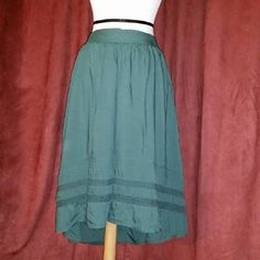 Dark Green High Low Skirt + loose fit + lightly used  + great condition + easily fits a medium + offers welcome via designated button Old Navy Skirts High Low