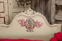 Close up of the headboard with some new decoupaged artwork. See MORE Junk Gypsies room makeovers here >> http://www.gactv.com/gac/on_shows_a-z/article/0,,GAC_26074_6067523,00.html