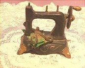 Vintage miniature sewing machine.