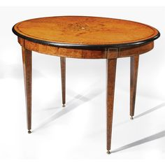 A Russian Neoclassical kingwood, burr-elm, ebonized and mother of pearl oval center table circa 1830