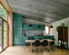 """Using different colours for the different spaces helped give the house a playful feel and a """"weightless"""" appearance, according to the studio, which angled some of the brickwork to show off the contrasting hues."""