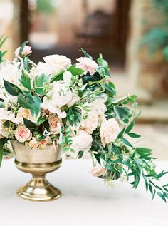 Romantic overflowing floral centerpiece: http://www.stylemepretty.com/texas-weddings/horseshoe-bay/2016/02/02/sultry-romantic-spanish-elopement-inspiration/ | Photography: Stephanie Brazzle - http://stephaniebrazzle.com/