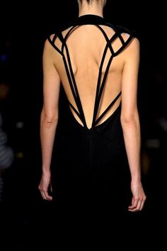 Unique open-back design dress.