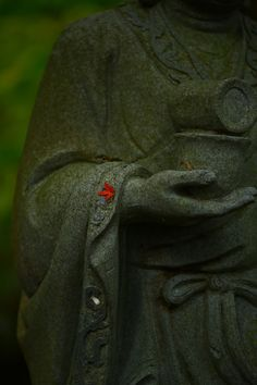 Jizo statue with autumn touch in Japan