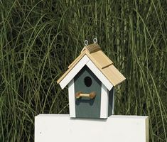 Add a cute detail to your yard and make bird friends with the Painted Garden Bird House with Cedar Roof from DutchCrafters Amish Furniture. This wooden birdhouse features a gabled cedar roof, perch, bird hole, and eye screws to hang it. Available in red with white trim, green with beige trim, blue with white trim, white with black trim, green with white trim, and navy with white trim. #birdhouses #painted #hanging #wooden #simple
