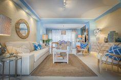 Ana Antunes | Sala de Estar | Living Room | Blue Inspiration | White Sofa | Blue Cushions | Hand-Woven Natural Rug | Wall Mirror | Coffe Table Decor | Sideboard | Palm Jungle Lampshades | Chairs | Home | Interior | Design