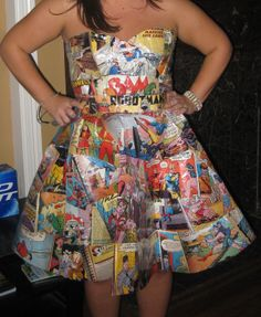 """Comic pages repurposed into a full-skirted dress! This was my favorite costume of the weekend. This handmade dress was assembled from comic book pages. A face-painted """"Pow"""" and """"Kaboom"""" headband completed the look. Clever, no? Halloween Mode, Scary Halloween Costumes, Halloween Fashion, Halloween Cosplay, Halloween Dress, Abc Costumes, Cute Costumes, Girl Costumes, Comic Costume"""
