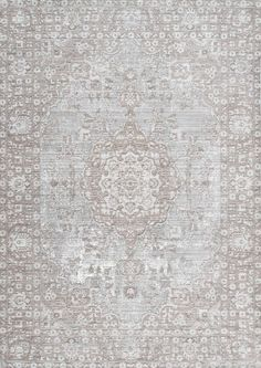 The 100% polyester, machine made medallion rug brings class and chic to your living space. The elegant design with subtle pattern is soft on the feet and works well for high-traffic areas in your home.