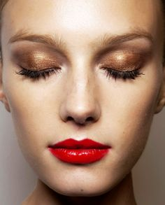 Gold/bronze eye shadow & a red lip — subtle shimmer & a little gloss