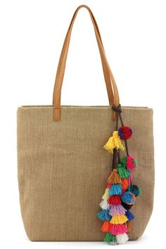 This is a MUST have Tote bag for this spring & summer season. It features a linen material, colorful threaded pom pom & tassel details, one inside compartment, 2 small pouches and a zippered pocket wi Mais Sacs Tote Bags, Reusable Tote Bags, Boho Bags, Designer Totes, Jute Bags, Cloth Bags, Handmade Bags, Purses And Bags, Burlap