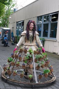 Nicole Dextras is a Vancouver artist who creates environmental art and ephemeral installations based on the principles of a socially engaged art practice. Her latest project is the Mobile Garden Dress which is part of her on-going series of wearable sculpture called Weedrobes.