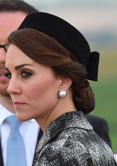 The Duchess wore her Balenciaga pearls as she looked out from the top of The Commonwealth War Graves Commission Thiepval Memorial on June 30, 2016 in Albert, France. Get the look: Balenciaga studs (Photo by UK Press Pool/UK Press via Getty Images)  via @AOL_Lifestyle Read more: https://www.aol.com/article/lifestyle/2017/03/15/kate-middleton-pearl-earrings-duchess-secret-elegant-weapon/21895932/?a_dgi=aolshare_pinterest#fullscreen