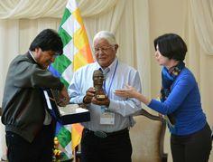 Bolivian President Evo Morales presents award to Leonard Peltier. Len Foster, spiritual leader of Peltier, accepts award on behalf of imprisoned prisoner of war.