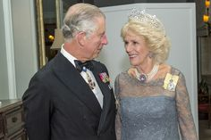 TRH the Prince of Wales and the Duchess of Cornwall, november 27th 2015. The duchess is wearing the Greville honeycomb tiara and her pearl choker with pink topaz with its matching earrings.