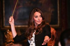 Happy Birthday Kate! Duchess of Cambridge waves her wand on the set used to depict Diagon Alley in the Harry Potter Films during the Inauguration Of Warner Bros. Studios in 2013