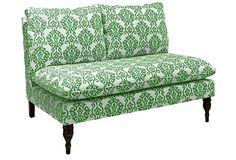 Bacall Armless Settee, Emerald. As comfortable as it is chic, this handcrafted settee is upholstered in vibrant cotton and features elegantly turned front legs. Generous padding ensures that this will become a favorite spot for lounging. Made in the USA.