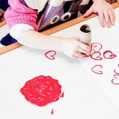 DIY TOILET PAPER HEART STAMP: Perfect project for kids. Make heart stamped wrapping paper using an old toilet paper roll!