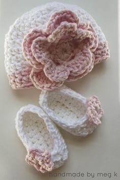 Handmade by Meg K: Crocheted Newborn Slippers. She used a medium yarn (4) called Cottontots by Bernat, hook was a crochet hook size 7. :)
